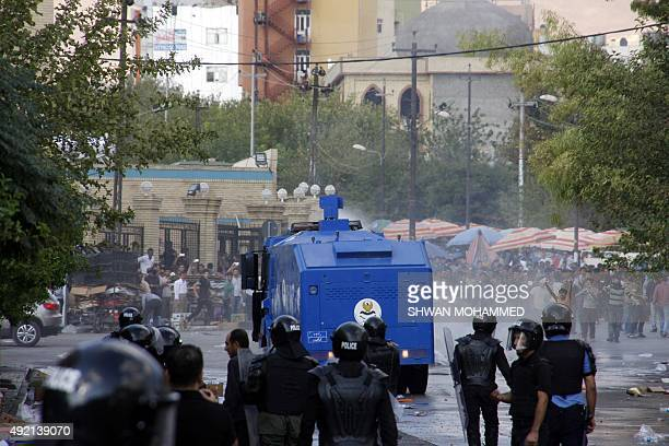 Security forces spray water at protesters during clashes in Sulaimaniyah in Iraq's Kurdistan region on October 10 2015 Two demonstrators including a...