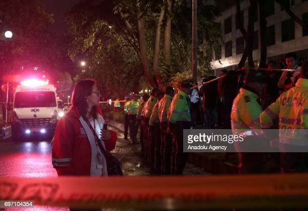 Security forces stand guard around the Andino shopping mall in Bogota Colombia Saturday June 17 2017 At least three women were killed and nine people...