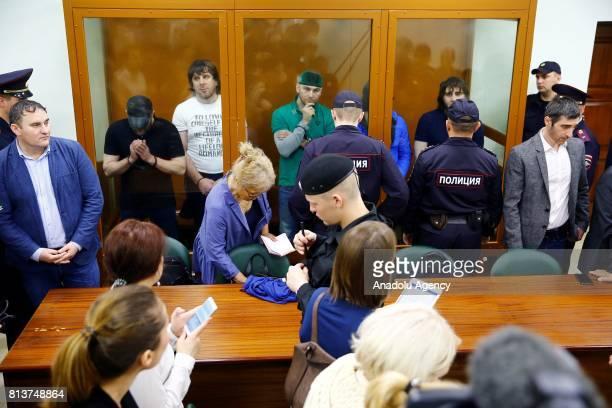 Security forces stand guard as Khamzat Bakhayev Temirlan Eskerkhanov Shadid Gubashev Anzor Gubashev and Zaur Dadayev who are convicted of organizing...