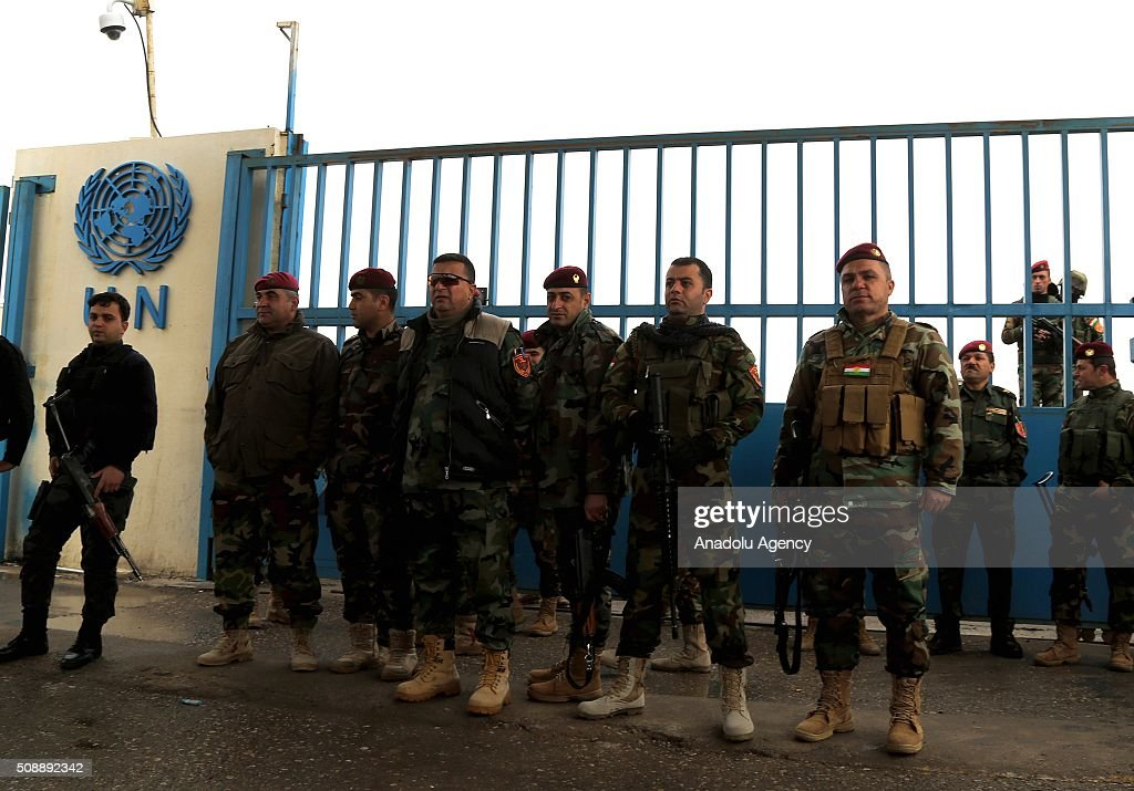 Security forces stand guard as supporters of terrorist organization PKK protest violently in front of UN office at Iraqi Kurdish Region, in Erbil, Iraq on February 7, 2016. PKK supporters attacked journalists during their violent protest.