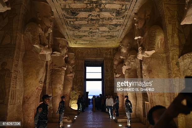 Security forces stand guard as tourists gather inside the temple of Abu Simbel south of Aswan in upper Egypt to witness the sun illuminate the statue...