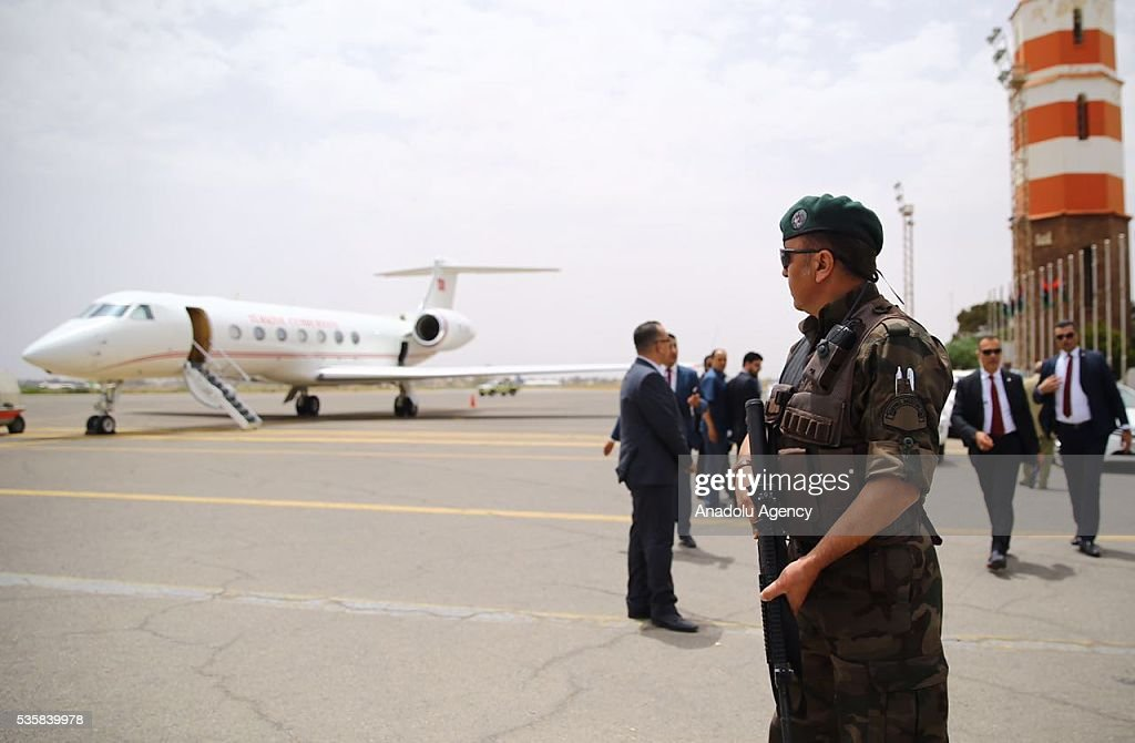 Security forces stand guard as Turkish Foreign Minister Mevlut Cavusoglu arrives in Tripoli, Libya on May 30, 2016.