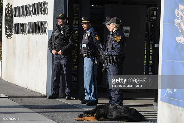 Security forces stand guard at the entrance of the United Nations headquarter in Geneva on December 10 2015 after Swiss police declared actively...