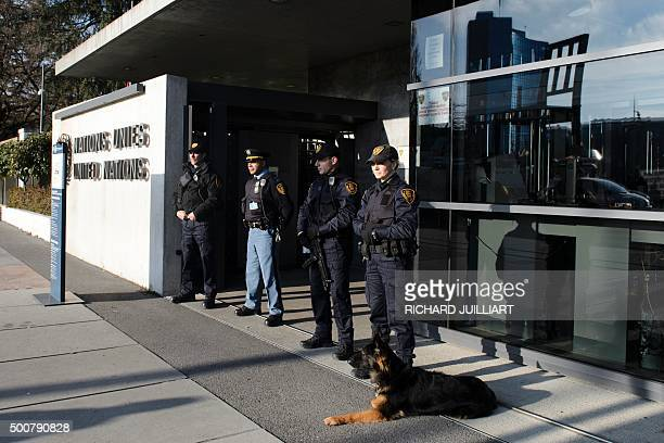Security forces stand guard at the entrance of the United Nations headquarters in Geneva on December 10 2015 after Swiss police declared actively...