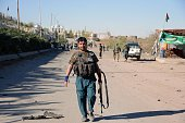 Security forces stand guard in the southern Afghan province of Kandahar after Taliban attack to a police headquarters on November 19 2015 According...