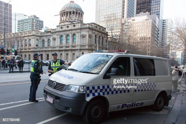 Security forces stand guard outside the court during Cardinal George Pell's court hearing at the Melbourne Magistrates Court in Melbourne Australia...