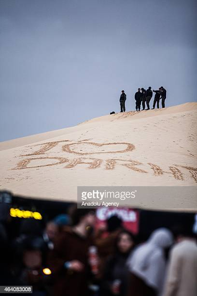 Security forces stand guard when Tunisians hold the electronic music festival 'Les Dunes Electroniques' on February 21 2015 at Ong Jmel near the town...