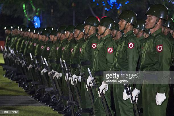 Security forces stand in silence during a military parade at flaghosting ceremony to mark the countrys 69th Independence Day in Yangon Myanmar on...