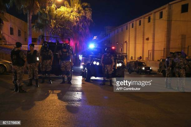 Security forces stand outside the Israeli embassy in the residential Rabiyeh neighbourhood of the Jordanian capital Amman following an 'incident' on...