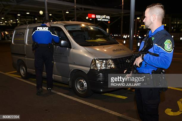 Security forces stop a van at the check vehicles arriving at Geneva's airoport on December 10 after police raised the alert level and searched the...