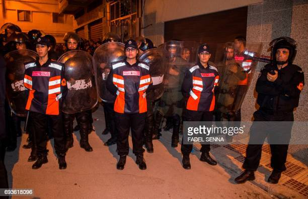 Security forces take position during a demonstration against corruption and employment in the northern Rif region June 8 2017 in Al Hoceima Morocco...