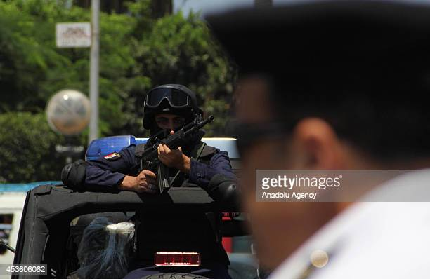 Security forces take security measures against protestors to hold demonstrations on World Rabaa Day marking the 1st anniversary of the killing of...