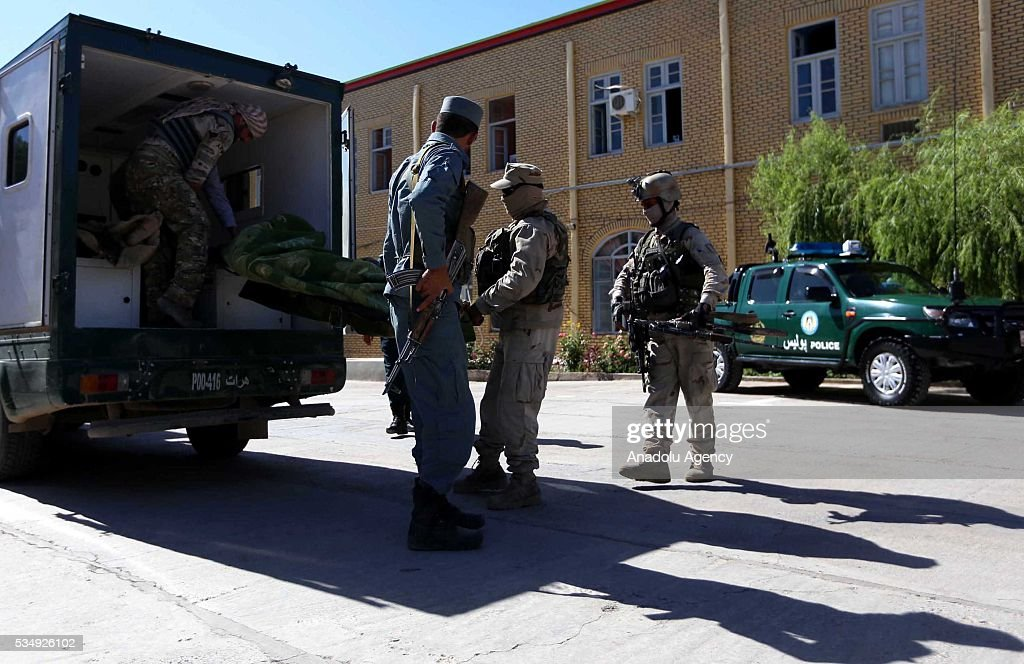 Security forces take security measures as they carry dead bodies following clashes with Taliban militants in Guzara District of Herat, Afghanistan on May 28, 2016. At least 5 killed during the clashes.