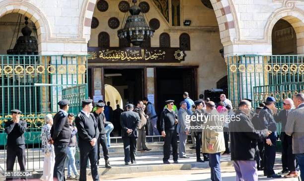 Security forces take security measures during the funeral ceremony of Egyptian actress and singer Shadia at the Sayyida Nafisa mosque in Cairo Egypt...
