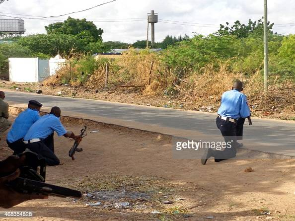 Security forces take up positions near the Moi university campus during an attack by Somalia's AlQaedalinked Shebab gumen in Garissa on April 2 2015...