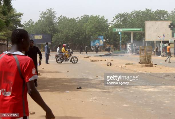Security forces try to disperse protesters as they stage a protest against government's budget law of 2018 in Niamey Niger on October 29 2017