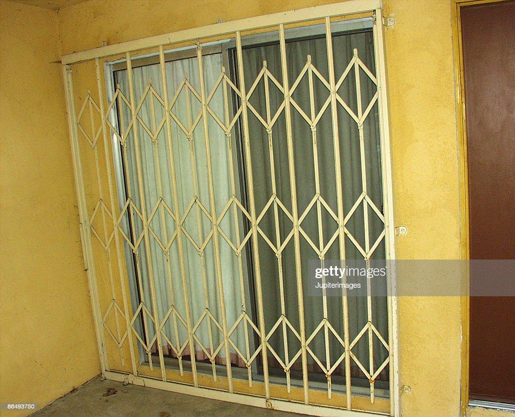 security gate across sliding glass door stock photo