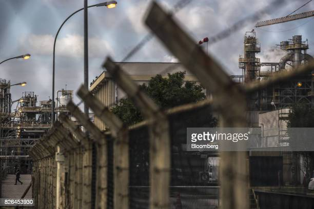 A security gate stands in front of the Braskem SA petrochemical plant in Duque de Caxias Brazil on Friday Aug 4 2017 Petroleo Brasileiro SA and...