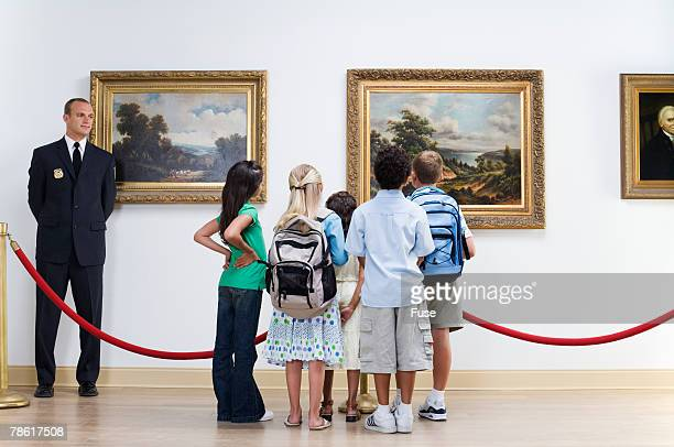 Security Guard and Elementary Students at Art Gallery