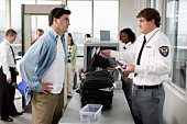Security guard and man at airport