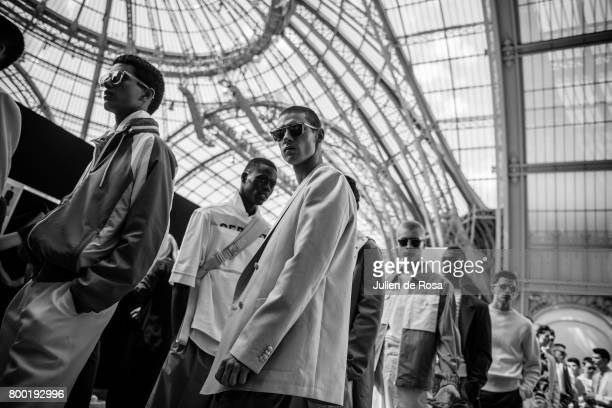 A security guard check inside backstage before the Cerruti Menswear Spring/Summer 2018 show as part of Paris Fashion Week on June 23 2017 in Paris...