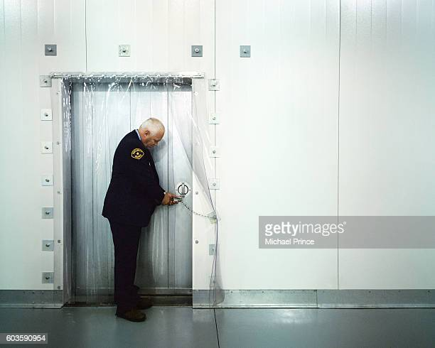 Security Guard Checking Door's Lock