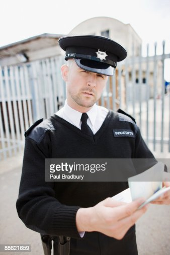 Security guard checking passport : Stock Photo