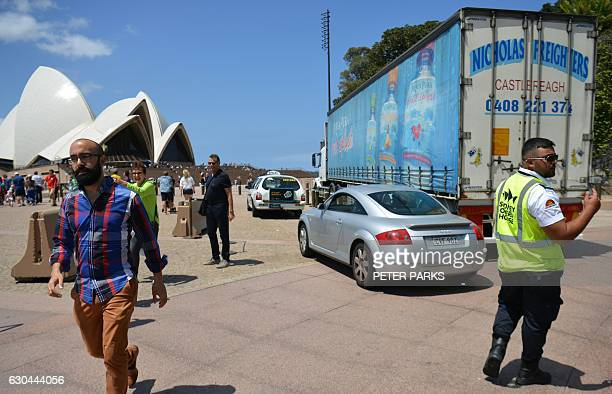 A security guard checks vehicles as they enter the underground carpark at the Opera House in Sydney on December 23 2016 A 'significant' Islamic...