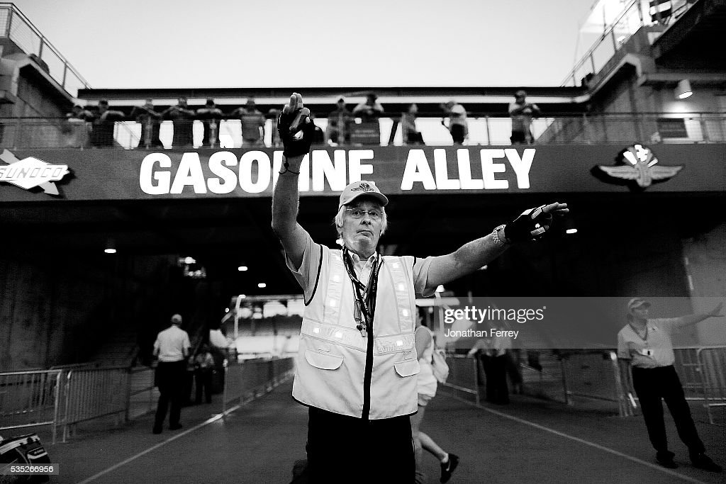 A security guard directs traffic in Gasoline Alley before the 100th Running of the Indianapolis 500 Mile Race at Indianapolis Motorspeedway on May 29, 2016 in Indianapolis, Indiana.