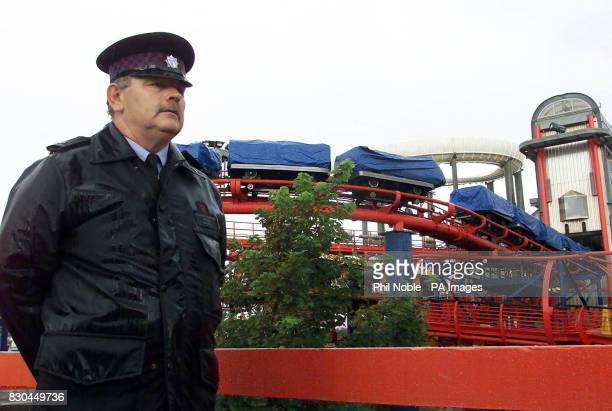 A security guard from Blackpool Pleasure Beach keeps watch over the Big One rollercoaster which is closed following a collision between two of its...