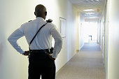 Security guard in an office corridor