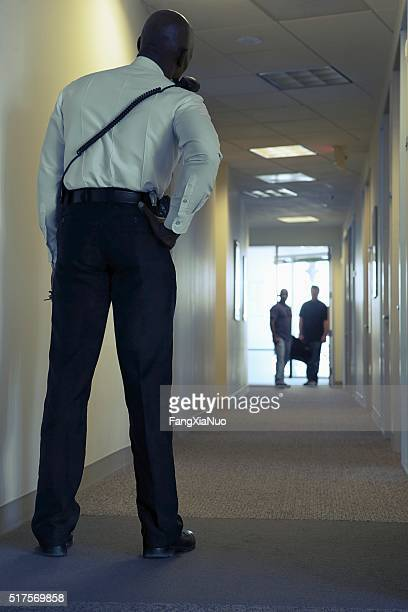 Security guard in an office corridor