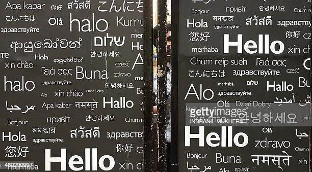 A security guard is seen behind a side entrance of a hotel decorated with the greeting 'Hello' in various languages in Mumbai on January 3 2014 AFP...