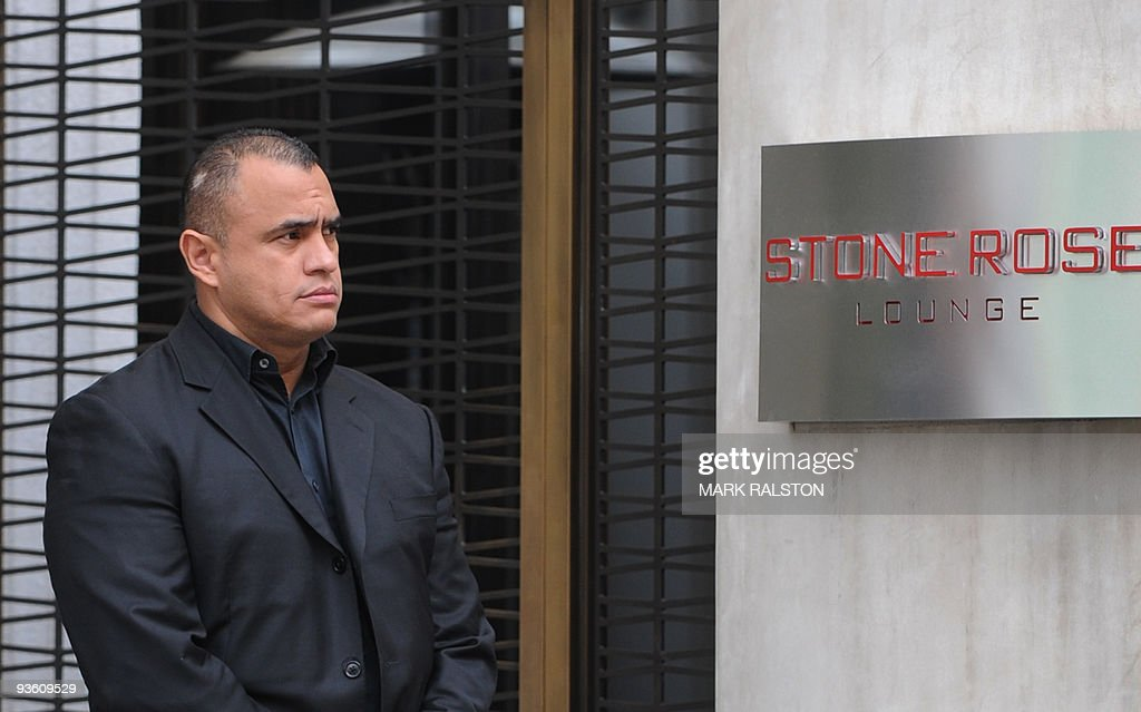 A security guard keeps watch outside the entrance to the Stone Rose Lounge where waitress Jaimee Grubbs was employed, in West Hollywood on December 2, 2009. Golfer Tiger Woods apologized for 'transgressions' in his family life as a magazine posted what it said was evidence of an extramarital affair between the golf superstar and Grubbs. It came hours after the celebrity magazine Us Weekly posted an online recording of what it said was Woods begging Los Angeles waitress Jaimee Grubbs to change her voicemail to hide their affair from his wife Erin. AFP PHOTO/Mark RALSTON