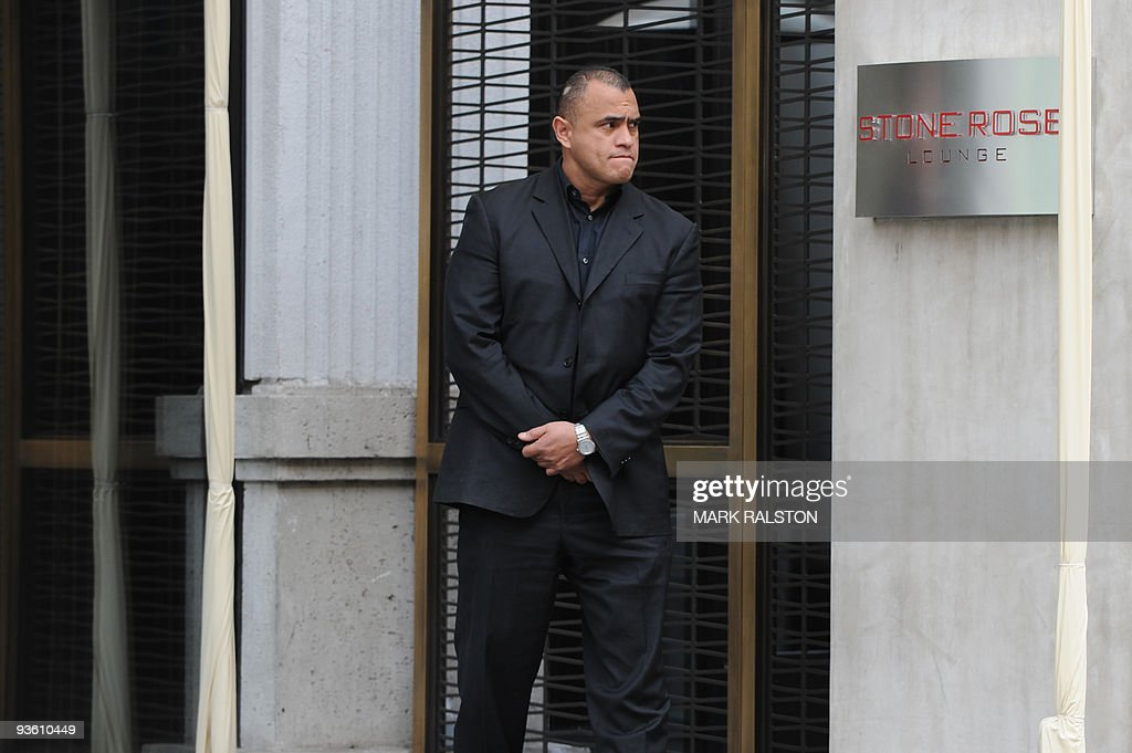 A security guard keeps watch outside the entrance to the Stone Rose Lounge where waitress Jaimee Grubbson was employed, in West Hollywood on December 2, 2009. Tiger Woods apologized for 'transgressions' in his family life as a magazine posted what it said was evidence of an extramarital affair between the golf superstar and a cocktail waitress. It came hours after the celebrity magazine Us Weekly posted an online recording of what it said was Woods begging Los Angeles waitress Jaimee Grubbs to change her voicemail to hide their affair from his wife Erin. AFP PHOTO/Mark RALSTON