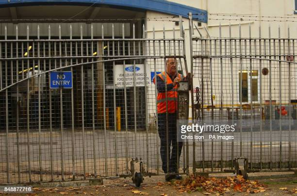 A security guard locks the gates after workers left the Ford Transit Assembly Plant in Southampton after being told that the site will close site...