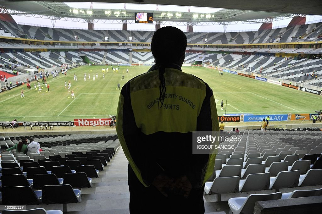 A security guard looks at the field from the terraces of the Mbombela stadium before the start a 2013 Africa Cup of Nation match Group D football match between Tunisia and Togo at the Mbombela stadium in Nelspruit, on January 30, 2013.