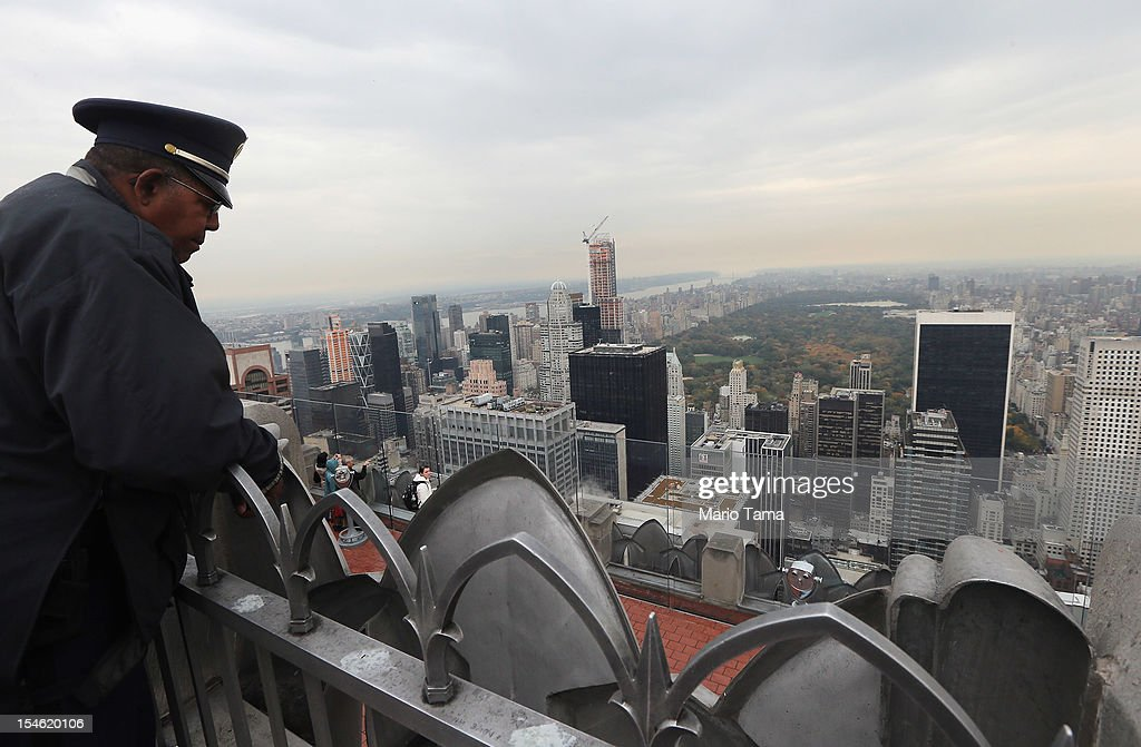 A security guard looks down towards Manhattan and Central Park from the 'Top of the Rock' observation deck at Rockefeller Center on October 23 2012...