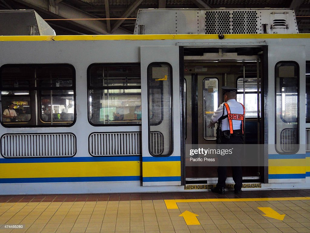 A security guard looks inside a train at a railway station in Monumento Railway operations along the Light Rail TransitLine 1 were temporarily...