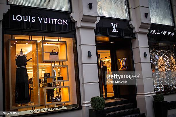 A security guard looks out the door of Louis Vuitton store in the famous Nisantasi shopping district on December 17 2015 in Istanbul Turkey With the...