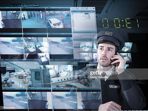 Security guard monitoring camera visuals on interactive screen