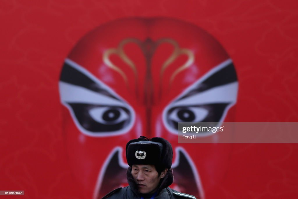 A security guard patrols during the Spring Festival Temple Fair at the Temple of Earth park on February 12, 2013 in Beijing, China. The Chinese Lunar New Year of Snake also known as the Spring Festival, which is based on the Lunisolar Chinese calendar, is celebrated from the first day of the first month of the lunar year and ends with Lantern Festival on the Fifteenth day.