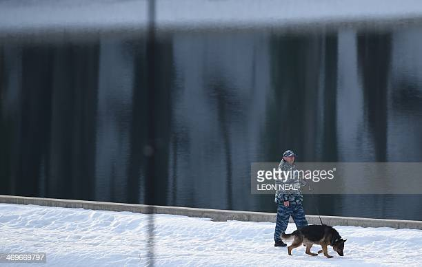 A security guard patrols the outer perimeter during the Men's Alpine Skiing SuperG at the Rosa Khutor Alpine Center during the Sochi Winter Olympics...