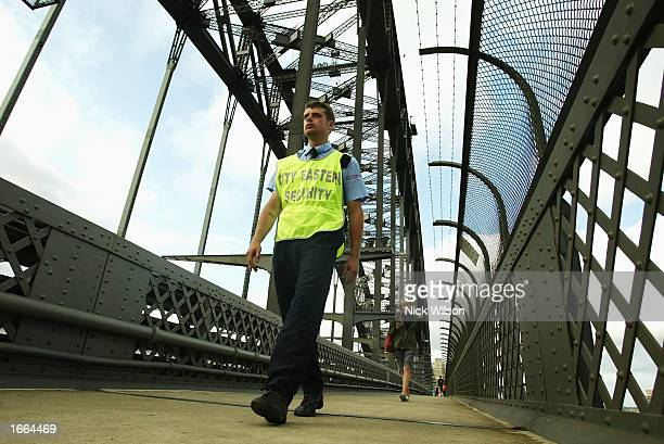 A security guard patrols the Sydney Harbour Bridge for possible terrorist activity as part of the increase in security on November 28 2002 in Sydney...
