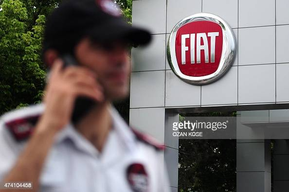 A security guard phones in front of the Fiat factory on May 20 2015 during a strike in Bursa the centre of the Turkish car industry The Turkey...
