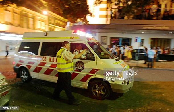 A security guard points the way for an ambulance crew in Newcastle 11 February 2006 NCH Picture by DARREN PATEMAN