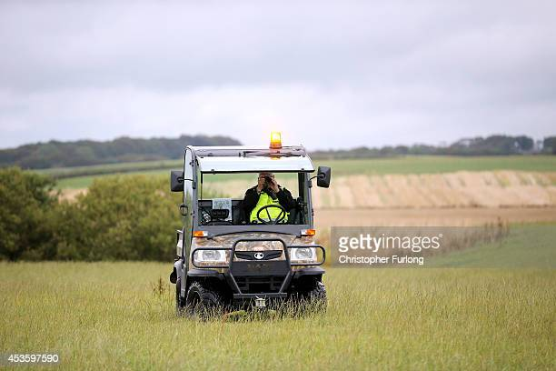 A security guard protecting a proposed drilling rig site at Westby near Blackpool photographs activists as they arrive at an antifracking camp near...