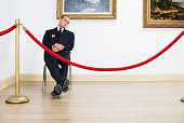 Security Guard Sleeping at Art Gallery