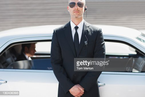 Security guard standing by car