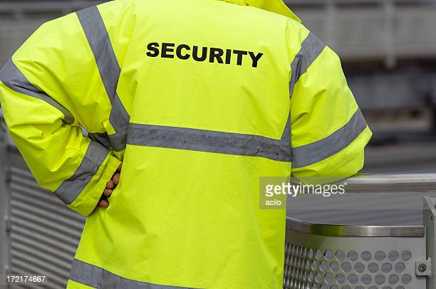 A security guard standing outdoors